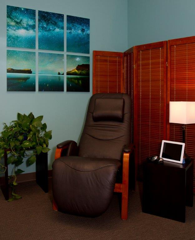 picture of stress reduction room with comfortable chair, photos, etc